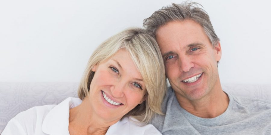 couple smiling | dental implants dedham ma